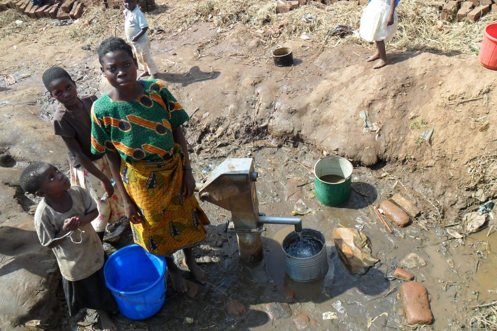 Woman collecting water in Kauma, Malawi