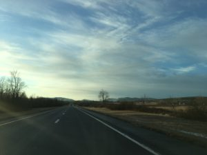 The Adirondack Mountains can be seen on the horizon from Interstate 87.